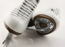 Blades of white figure skates.
